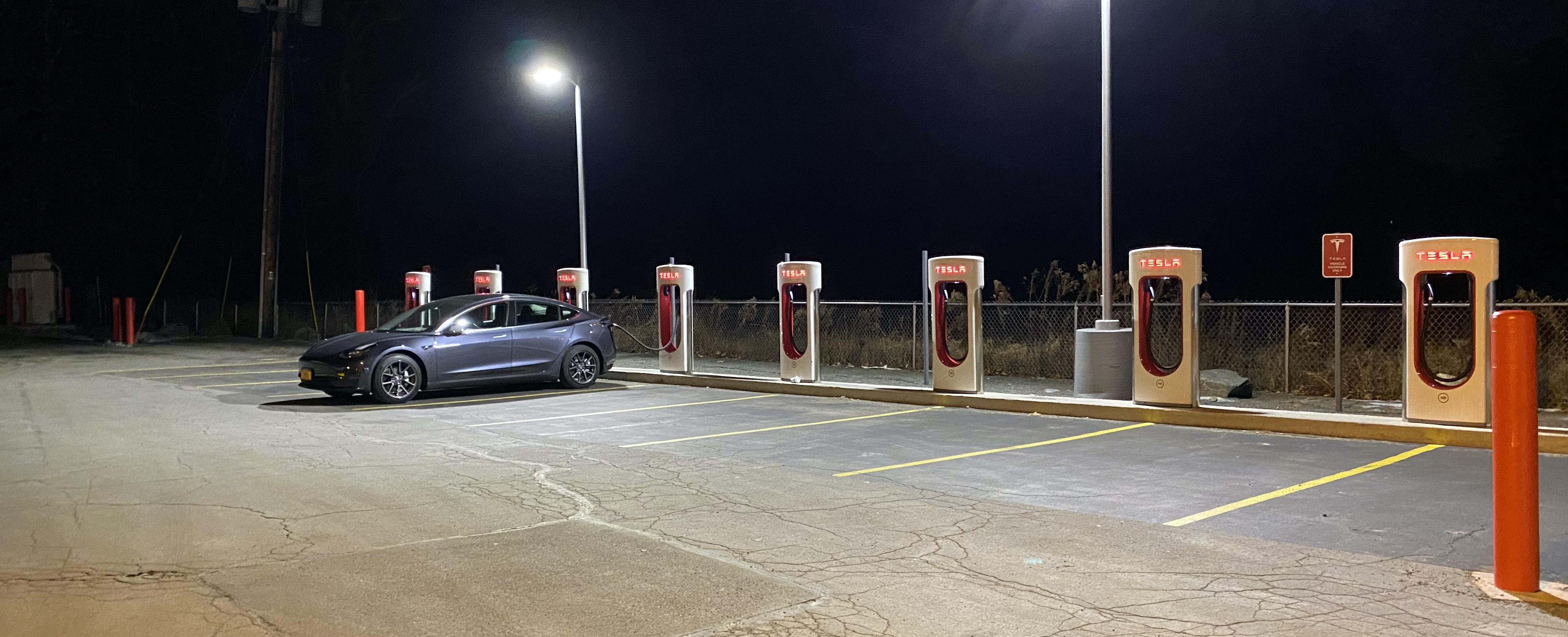 Tesla Model 3 Supercharging at Night Alone